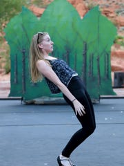 "Bonnie Harris rehearses for her role as one of the ""Silly Girls"" in Disney's ""Beauty and the Beast"" Wednesday evening at Tuacahn Amphitheatre in Ivins City."