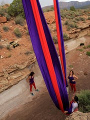 Cheryl Broughton, Summer Davies and Annie Berry prepare their aerial fabrics for a performance in Springdale.