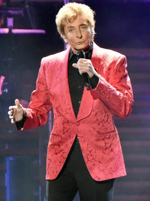 """Barry Manilow seen here performing on stage during the One Last Time Tour in February in Chicago, will take part in """"A Capital Fourth 2015"""" airing Saturday at 8 p.m. on PBS SoCal."""