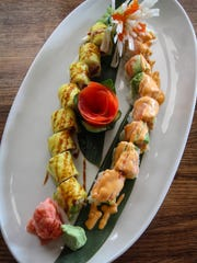 A Tuna Roll with soy paper and a Spicy Tuna Roll with