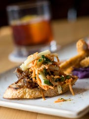 Banh mi-inspired duck confit on toast ranks among the small plates being served at the Oct. 15 pairing at the Depot.