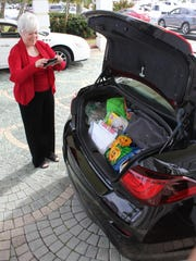 Debby Roddy snaps part of a carload of goodies destined for the Shelter for Abused Women and Children in Naples.