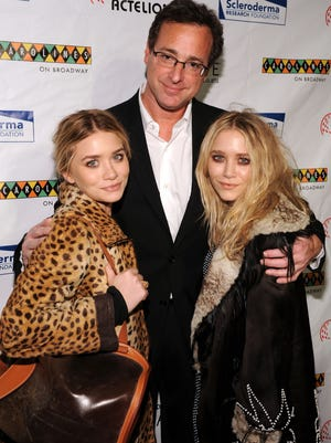 """NEW YORK - NOVEMBER 09:  Actors Mary-Kate Olsen, Bob Saget and Ashley Olsen attend """"Cool Comedy Hot Cuisine 2009"""" hosted by the Scleroderma Research Foundation at Carolines On Broadway on November 9, 2009 in New York City.  (Photo by Bryan Bedder/Getty Images) ORG XMIT: 92864040 GTY ID: 64040BB002_THE_SCLERODER"""