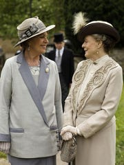 "Penelope Wilton as Isobel Crawley, left, and Maggie Smith as Violet, Dowager Countess of Grantham in ""Downton Abbey."""