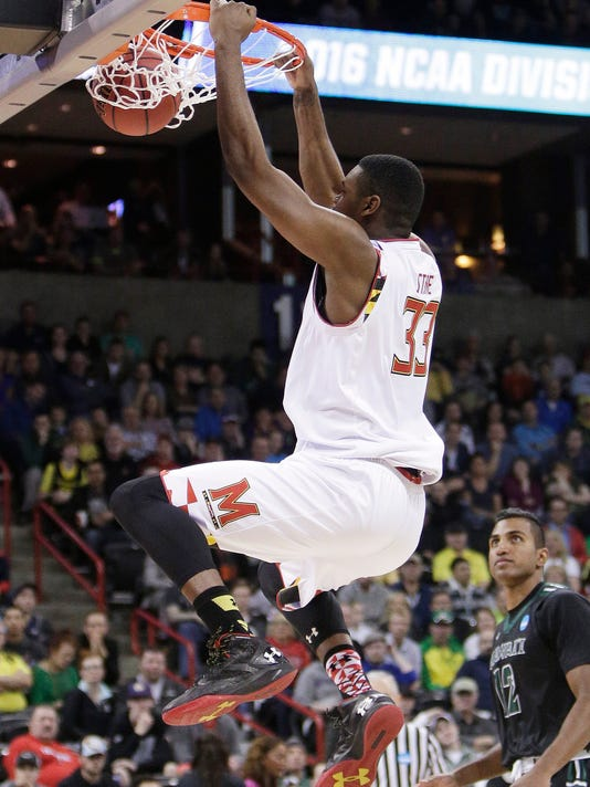 Maryland center Diamond Stone (33) dunks during the first half of a second-round men's college basketball game against Hawaii in the NCAA Tournament in Spokane, Wash., Sunday, March 20, 2016. (AP Photo/Young Kwak)