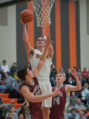 Ben Vander Plas of Ripon goes up for a layup while defended by Ryan Hummel (24) and Scott Kramer of Winneconne on Tuesday in Ripon.