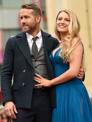 Actors Ryan Reynolds (L) and Blake Lively pose for