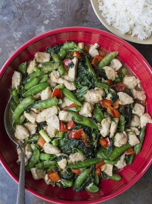 Chicken and vegetable stir-fry with ginger and oyster sauce cooks up in a half hour.