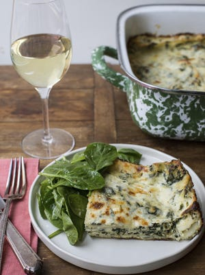 Cheesy white and green spinach lasagna is filled with sauteed spinach folded into fluffy ricotta and a very simple béchamel sauce, rich with melty cheeses.