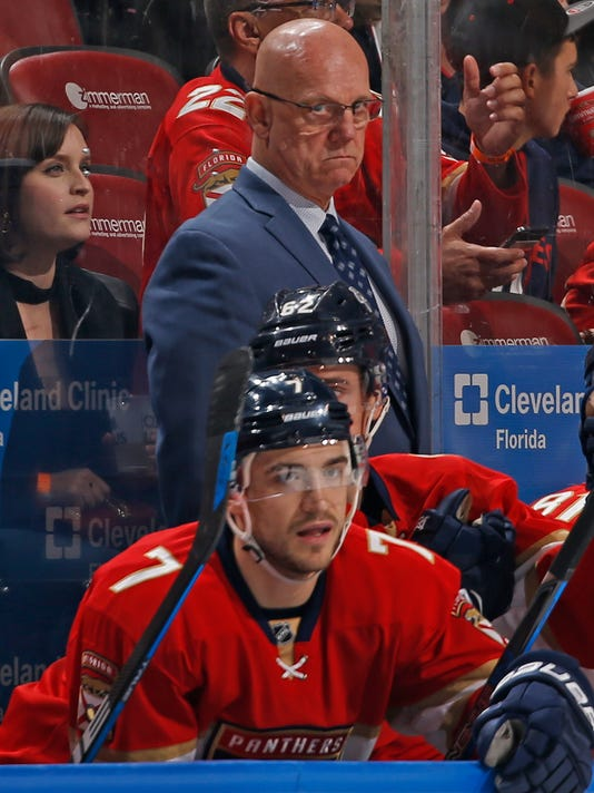 Florida Panthers interim head coach Tom Rowe, center top, looks on during the second period of an NHL hockey game against the Buffalo Sabres, Saturday, April 8, 2017, in Sunrise, Fla. (AP Photo/Joel Auerbach)