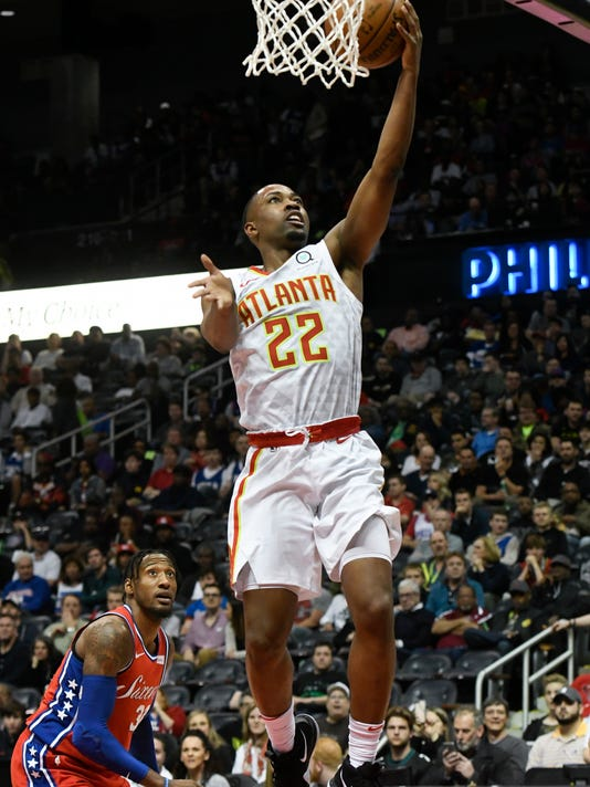 Atlanta Hawks guard Isaiah Taylor (22) shoots as Philadelphia 76ers forward Robert Covington looks on during the second half of an NBA basketball game Friday, March 30, 2018, in Atlanta. (AP Photo/John Amis)