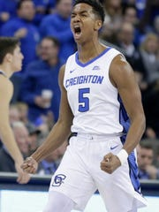 Creighton's Ty-Shon Alexander (5) reacts after scoring a three-point basket during the first half of an NCAA college basketball game against Villanova in Omaha, Neb., Sunday, Jan. 13, 2019. (AP Photo/Nati Harnik)