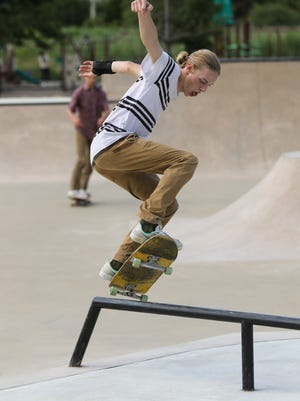 A skateboarder tries out the newly expanded skate park at Veterans Way Park in Hudson Friday. The expansion work at the park was finished at the end of July. Rails such as these are set up in several spots of the park.