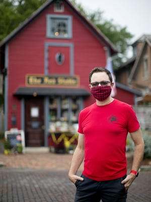 Jeff Smith, owner of Red Stable Souvenirs and Gifts in German Village, works on an online order.