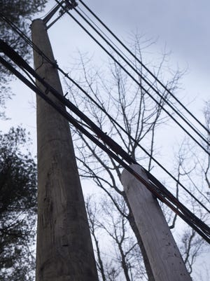 Several Seacoast officials have signed on to a formal complaint filed with the N.H. Public Utilities Commission against Consolidated Communications over utility poles that the company have left in place after new ones were installed.