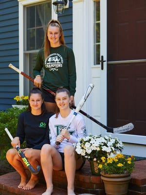 Sisters, from left,  Chase, Lily and Phoebe Holmes have maintained a strong family influence on the athletic programs at Dennis Yarmouth Regional High School. Chase and Phoebe are anticipating one more autumn as field hockey teammates, while Lily moves on to Endicott College.