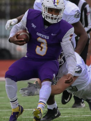Kansas Wesleyan junior Tony Brown (3) runs with the ball during a game on Oct. 24 against Avila at Graves Family Sports Complex.