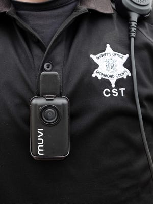 Body cameras, such as the one worn by a Richmond County Sheriff's Office deputy in this file image, are being purchased by law enforcement agencies across the county to help document evidence and keep officers accountable.