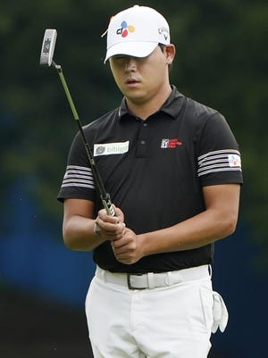 Si Woo Kim, of South Korea, lines up a putt on the first hole during the third round of the Wyndham Championship golf tournament at Sedgefield Country Club on Saturday, Aug. 15, 2020, in Greensboro, N.C.
