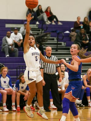 Cedar Ridge's Mikayla Johnson, attempting a shot against Westlake last season, had 12 points for the Raiders in their win over Manor last week.