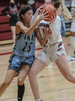 Salina Central's Landry Stewart (11), draws a tie-up with Eisenhower's Kennedy Nicholson (25) during Tuesday's game at the Central gym.