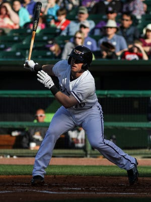 Louisville's Tucker Barnhart (16) hits the ball while playing the Toledo Mud Hens at Louisville Slugger Field in Louisville, Ky. April 11, 2015.