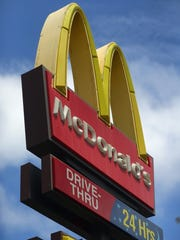 A sign for a McDonald's restaurant is seen.