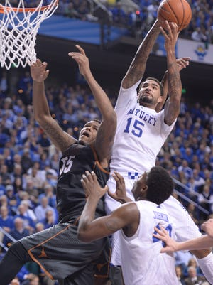 UK's Willie Cauley-Stein grabs a rebound during the University of Kentucky men's basketball game against Texas at Rupp Arena in Lexington, Ky. Friday, December 5, 2014.
