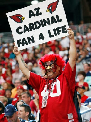 Arizona Cardinals fans cheer as they face the Dallas Cowboys in their NFL game Saturday, Aug. 17, 2013, in Glendale.