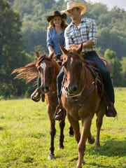 """Britt Robertson (left) and Scott Eastwood appear in a scene from """"The Longest Ride."""""""