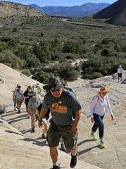 Intermountain Healthcare's Southwest Region Executive Team hikes up into the Whiterocks Amphitheater in Snow Canyon State Park.