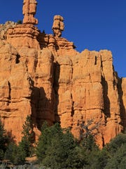 A series of red rock hoodoos captivate travelers passing through Red Canyon in the Dixie National Forest between Panguitch and Bryce Canyon National Park.