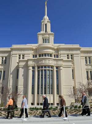 Members of an interfaith group from Southern Utah, including Pastor Jimi Kestin of Solomon's Porch Foursquare Fellowship in St. George, left, and the Rev. Bob Sharp of Trinity Lutheran Church in Cedar City, right, attend an open house Wednesday for the Payson Utah Temple of The Church of Jesus Christ of Latter-day Saints.