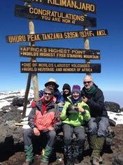 Lisa Eckert, front, center, poses with other National Park Service employees at the summit of Mount Kilimanjaro during a January trip to Africa.