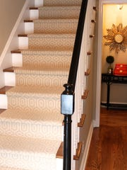 In her own suburban New York home, designer Lori Elder Dyner tried out various carpet color and pattern samples and selected one lighter than she anticipated for her front stairway. Wood treads and white painted risers complete the transitional look.