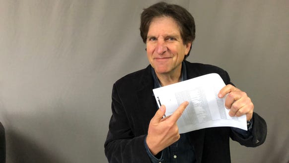 Jefferson Graham holds his downloaded Apple data, which