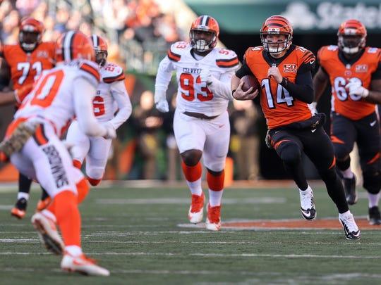 Cincinnati Bengals quarterback Andy Dalton (14) runs