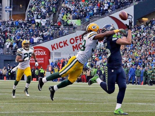 FILE - In this Sunday, Jan. 18, 2015, file photo, Seattle Seahawks' Jermaine Kearse, right, catches the game-winning touchdown pass during overtime of the NFC championship NFL football game against the Green Bay Packers in Seattle. Kearse was having an NFC championship game to forget until the final play. That's when the Seahawks receiver added yet another memorable postseason touchdown to his resume. (AP Photo/Jeff Chiu, File)
