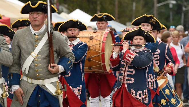 Members of the Tippecanoe Ancient Fife and Drum Corps perform on Main Street during the 34th annual Kunstfest in New Harmony Saturday.  The event continues Sunday with over 300 booths offering arts, crafts, food and other interactive displays as well as live music.