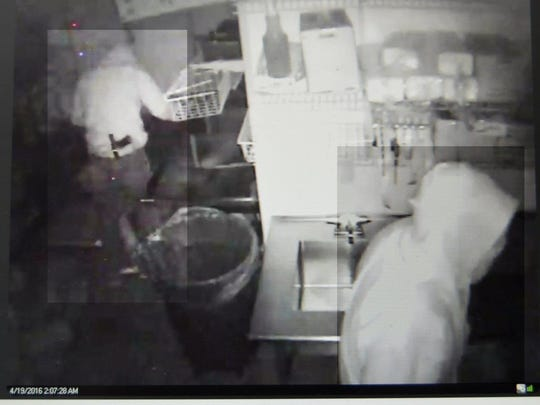 A submitted security of photo of two men burglarizing a Subway restaurant in Carson City earlier this week.
