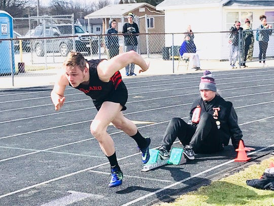 Ashland's Hudson McDaniel charges out of the blocks and goes on to easily win the 300 meter hurdles in Saturday's Lexington Invitational.