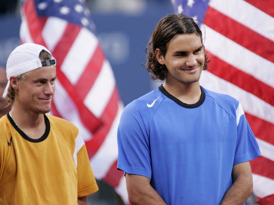 In a file photo from 2004, Roger Federer right, with