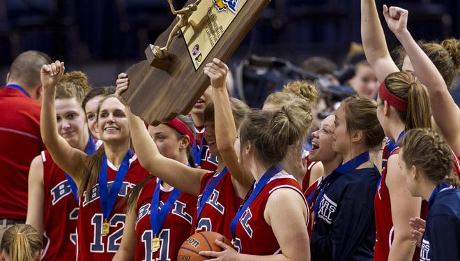 Bedford North Lawrence players celebrate winning the IHSAA Girls Basketball Class 4A Championships, Saturday, March 8, 2014, in Terre Haute, Ind.  Bedford North Lawrence High School defeated Penn High School 51-41. (AP Photo/Doug McSchooler)