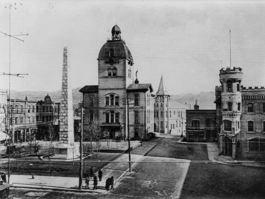 Asheville's Court Square, circa 1899, shows Vance Monument two years after it was erected, close by the sixth Buncombe County courthouse.