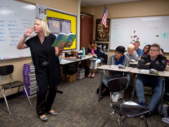 Marcia Mishler reads Charles Dickens' Great Expectations with her 9th grade class at Gibson Southern High School in Evansville, Ind., on Wednesday, Sept. 20, 2017.