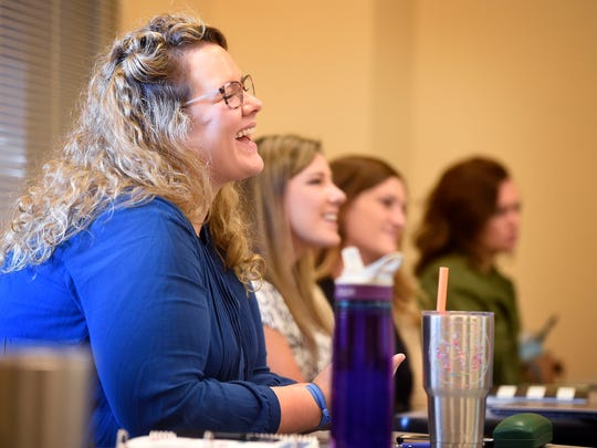 Student Rachelle VanMeter listens with other students as Erin Shankels, a nurse practitioner, talks to the class of nurse practitioner students at Belmont about working under differing regulations in other states. Friday Sept. 9, 2016, in Nashville, Tenn.