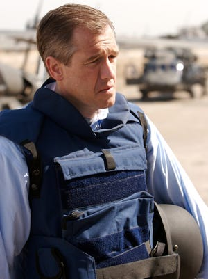 """Brian Williams of """"NBC Nightly News"""" reports from Camp Liberty in Baghdad, Iraq, on March 8, 2007."""