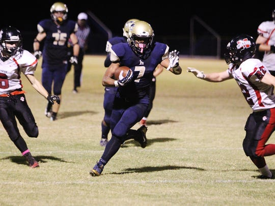 John Paul II wide receiver Sam Smith sprints toward the end zone in the Panthers' victory over the visiting Munroe Bobcats Friday night.
