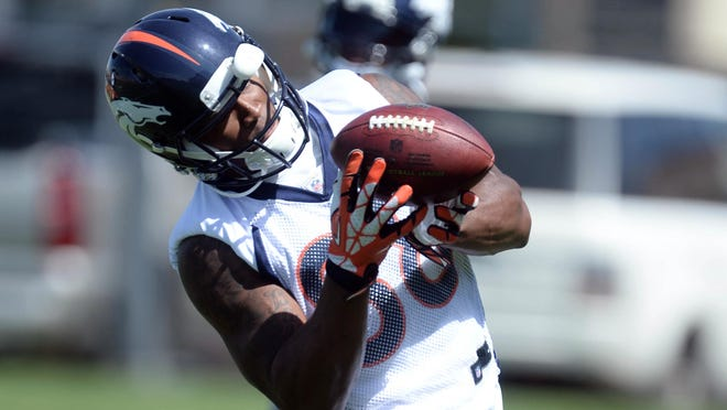 Denver Broncos wide receiver Demaryius Thomas (88) pulls in a pass at the Broncos practice facility in Englewood, Colo. on June 10, 2014.