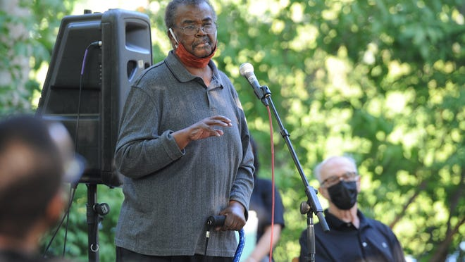 """John Reed, president of NAACP Cape Cod, speaks at the """"Cape Cod Cares"""" event held in Sandwich Sunday evening. About 100 people gathered at Mill Creek Park to hear speakers and show solidarity with the Black Lives Matter movement before they marched along Main Street to Route 6A."""